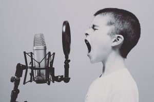 Voice Projection Exercises - Boy Shouting into Microphone